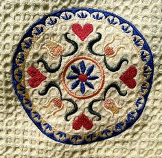Pa Dutch Hex Sign embroidered on kitchen towel. $12.00, via Etsy.