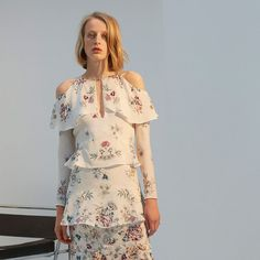 Russian designer Olga Vilshenko grew up by her mother's side, watching her create beautiful one-of-a-kind pieces, bypassing the austerity of fashion in the country's communist routine.  The first collection for her label debuted in Spring/Summer 2011, presenting her Eastern heritage with Westernised silhouettes, all with a folkoric twist. These distinctive traits still stand the test of time today with her opulent embroideries and demure shapes perfect for noon and night.