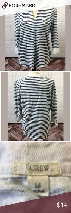 J. Crew Medium Striped Top J. Crew Medium Top  White and Navy Blue - Faded look  Striped  3/4 Sleeve  V-neck  Front Pocket Tabs - There are no pockets in front.  There's a light pink/red spot on bottom of sleeve near buttons. See picture. Still in great condition!  Pictures were taken in a smoke-free, pet-friendly environment away from the pets.  See pictures for fabric content, cleaning instructions and measurements.  ?I check all items for flaws and include any in the listing. If I have…