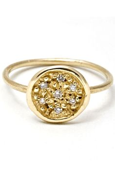 #refinery29  http://www.refinery29.com/19565#slide6  Yayoi Forest Seven Diamond 14k Ring, $620, available at Yayoi Forest.
