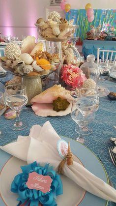 mesa decorada con caracoles