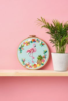 Arriba! You can't get much more tropical than this incredible flamingo wall art. #EmbroideryArt