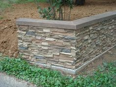 A retired contractor built this stacked stone retaining wall with faux panels to match the southwestern look of his home. Rock Retaining Wall, Retaining Wall Design, Landscaping Retaining Walls, Faux Panels, Stone Panels, Faux Stone Walls, Brick And Stone, Fake Stone, Stone Masonry