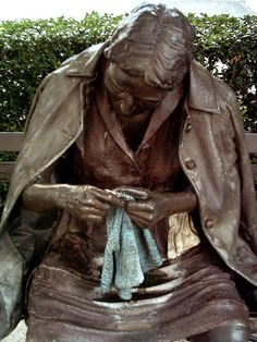 Statue of a knitter located in downtown Dallas, TX. The knitter statue is near the corner of Ross and Olive street near the Dallas Museum of Art downtown.