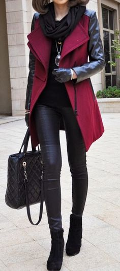 Winter street fashion, black shirt, leather leggings over red peacoat