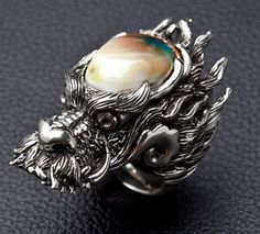 http://www.bikerringshop.com/v/vspfiles/assets/images/silver-dragon-rings.jpg