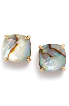 Lightly faceted semiprecious stones center versatile stud earrings that expertly catch and reflect the light.