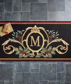 Embrace the yuletide spirit. Durable enough to stand up to the elements, this polypropylene entry mat features a festive holly and mistletoe arrangement and an optional single initial monogram. Perfect for adding a holiday touch to your entryway.
