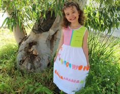 Rami with showing off her finished creation! Tulip Painting, Library Bag, Calf Length Dress, Unique Words, Blank Canvas, Wearable Art, Gifts For Kids, Gift Tags, Party Dress
