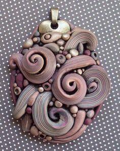 """Crazy Swirls Pendant"" by Kris Kapono aka MandarinMoon at Deviant Art."