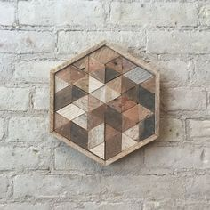 This is a graphic and geometric reclaimed wood design that is made from repurposed lath. It is ready to hang and would make a great statement piece for a gallery wall. The piece would also look great sitting on a shelf or mantel or a centerpiece on a table. Can be customized.