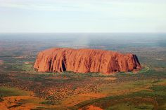 A one-of-a-kind shot of Uluru (Ayers Rock) in the Northern Territory, central Australia just south west of the nearest large town, Alice Springs.  The photo was taken by photographer/pilot Dr. Jörg Fierlings.