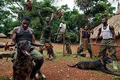 Members of the Ugandan army's dog-tracking team lift weights at the African Union base in Obo Central African Republic [2400  1600]