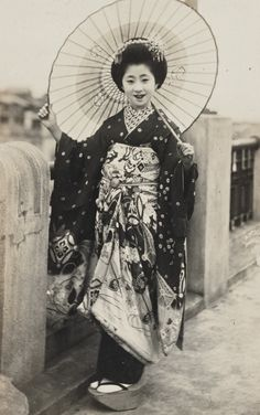 Maiko with parasol.  About 1930's, Japan