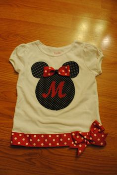 I like the ribbon at the bottom!   Minnie Mouse shirt!