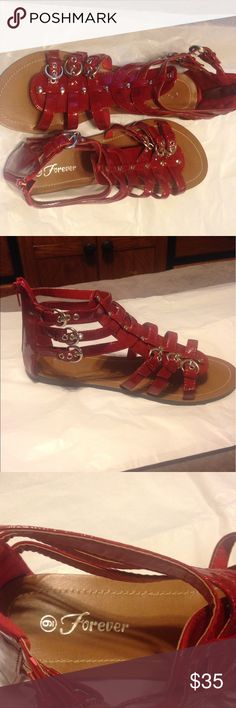 NWOT red buckle Forever sandals 👠 shoes. These are new never worn bright red Forever sandals with buckles size 9. Small place on inside shoe doesn't affect the shoe not seen when worn. Picture. From a smoke free home with fur baby 🐶 Forever Shoes Sandals