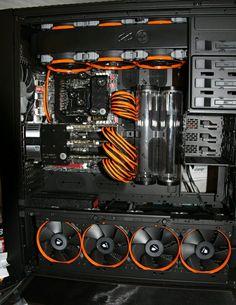 Orange and black computer PC tower setup liquid cooled case
