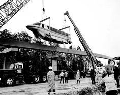 The Walt Disney World Monorail being placed on the beam before WDW opened in 1971 from www.imagineeringdisney.com