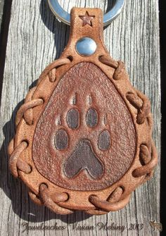 Made this leather keychain with a dog paw and handmade ivory glass beads. All handmade, handtooled and designed by Jeweleeches Vivian Hebing! Do you want to see more of my work, you can find me on Facebook, Youtube and Etsy too! On Youtube you can see my tutorial video's! https://www.youtube.com/channel/UCaFFog0cL9EV5ITUjTO_0hw
