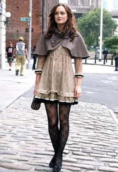 A young Blair Waldorf pairs a Trina Turk cape and a Marc by Marc Jacobs dress with her signature pattern tights.