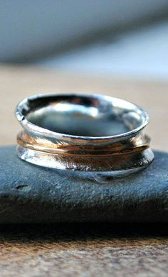 Sterling silver ring with gold band