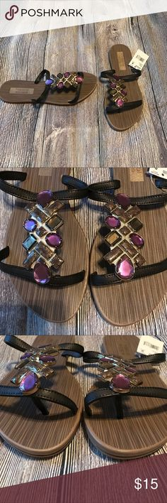 Jeweled sandals Never worn. Cute black sandals with purple and gold accents Shoes Sandals