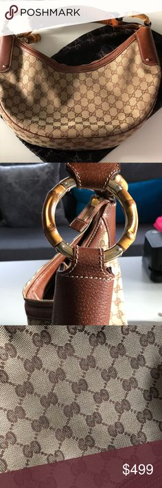 """Gucci Bamboo Hobo Excellent Condition!!! - GG canvas body with leather trim  - Pale gold tone hardware  - Single shoulder strap  - Zip top closure  - Bamboo ring detail  - Debossed designer lettering  Interior  - Fabric lining  - 1 zipper pocket   Measurements (inch)  Length (at widest) 14.6""""; Height (at center) 7.5""""; Width 2.4""""; Shoulder Strap Drop 7.9""""  - comes with accompanying Gucci protective bag Gucci Bags Hobos"""