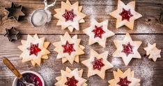 Christmas Linzer cookies with raspberry jam by nblxer. Christmas Linzer cookies with raspberry jam on a rustic wooden background Christmas Candy, Christmas Baking, Christmas Time, Star Cookies, Holiday Cookies, Most Popular Desserts, Kinds Of Cookies, Galletas Cookies, Cookies Et Biscuits