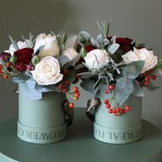 This Nordic style mini hat box duo is a mixture of luxury scented Cream Piaget & Snowballet roses with Red Sensation roses which are exclusively grown on our farm in Kenya. We have mixed these beautiful roses with Rose Hips in this pretty arrangement with aromatic herbs and seasonal winter foliage, all grown on our English Farm. The mini hat boxes make a lovely keep sake after the flowers have faded.