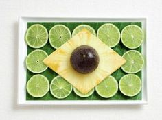 Brazil flag, made from banana leaf, limes, pineapple, and passion fruit.