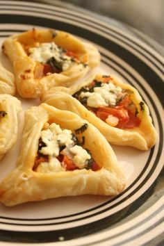 Mediterranean Hamantaschen - puff pastry dough, tomatoes, onions, basil, goat cheese