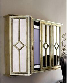 TV Wall Cabinet - Mirrored...I don't like the pattern on the mirrors but I love the idea for over the fireplace....This could work !!!!                                                                                                                                                                                 More