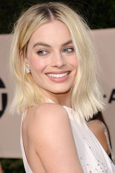 Debuting a new, blonder hair hue, Margot Robbie opted for an unabashedly feminine beauty look, with pastel pink blush, sparkling eyeshadow and petal-toned lipstick.