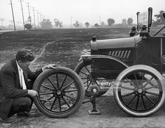 man-kneels-outdoors-to-change-the-front-tire-on-his-model-t-ford-one-picture-id3245310 (1024×795)