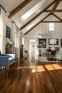 Open living room design with vaulted ceiling and exposed beams