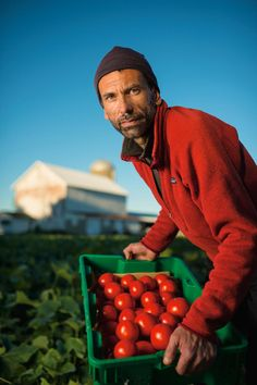 Chris Covelli, Wisconsin, United States, holding tomatoes FACES OF FARMING All around the world, small farms are playing a big role in feeding the world. These are a few of the men and women behind that effort. PHOTOGRAPHS BY JIM RICHARDSON