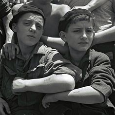 Once Upon A Time In War - Jewish youths rescued from Auschwitz show their tattoos on board the refugee immigration ship Mataroa at Haifa port, in what would later become the State of Israel, on July 15, 1945.