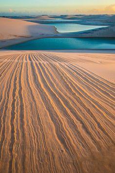 Dune patterns and freshwater lakes, Lencois Maranhenses National Park, Brazil. Tom Till Photography