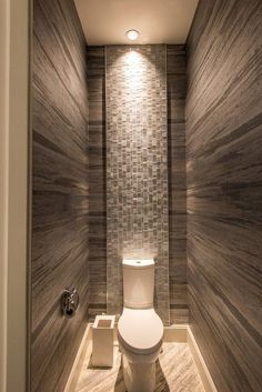 The Best Bathroom Tile Ideas and Design for 2018 - This modern bathroom utilizes a minimal color design with white wall surfaces and also tones of dark grey porcelain wall and flooring ceramic tiles. Best Bathroom Tiles, Bathroom Toilets, Bathroom Layout, Bathroom Small, Bathroom Ideas, Beautiful Small Bathrooms, Amazing Bathrooms, Bathroom Design Luxury, Modern Bathroom Design