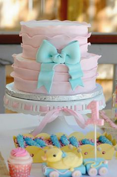 Don't really care for the blue ribbon... but I like how soft the cake looks on the stand on the table... just pretty!