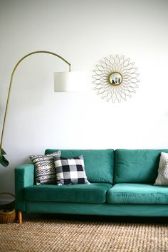Our experience ordering and installing a custom sofa cover and legs for our IKEA Karlstad sofa from ComfortWorks. Our statement green velvet sofa in our living room!