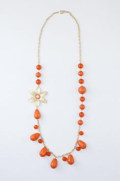 Dressing Your Truth - Type 1 Sun Burst Necklace     The essence of fun and bright, this gold colored necklace features tear dropbeads and a bright lily bloom for the perfect hint of sun-kissed shimmer.        29 inch      Trigger Clasp  tomatoes!