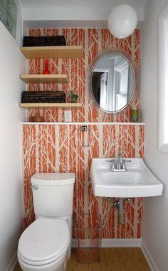Trees ~ Pattern Wall Tiles spotted in Cameo Ibsen's powder room. From The Kansas City Star. (ledge running from sink to over the toilet). Monkey Wallpaper, Orange Wallpaper, Modern Wallpaper, Of Wallpaper, Wallpaper Accent Wall Bathroom, Powder Room Wallpaper, Downstairs Toilet, Downstairs Cloakroom, Master Bathroom