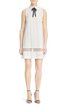 Free shipping and returns on Alice + Olivia 'Irena' Illusion Lace Sheath Dress at Nordstrom.com. A sheer illusion panel cuts the sweetness of this delicate white lace sheath, styled with a sharp spread collar and slender, high-contrast black tie.