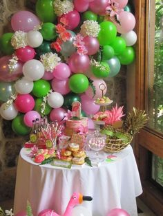 Such an awesome Pink Flamingo birthday party! It has a tropical feel to it. The balloon backdrop is amazing!