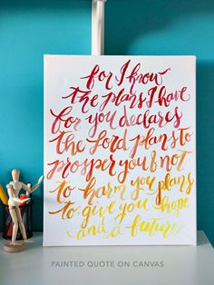 Give a meaningful quote some handmade flair by painting it onto a blank canvas in ombre hues.