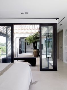 Piet Boon Styling by Karin Meyn. One of the homes we viewed just now had a clear glass bathroom in the master bedroom like this. woah!