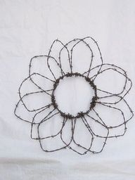 barb wire sunflower to put on grainery in the summer