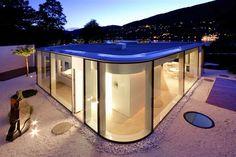 Rounded glass pavilion house on Lake Lugano