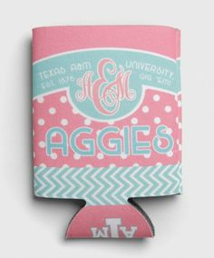 "This cute koozie has a pink and teal color scheme with polkadot and chevron patterns. One side reads ""Texas A&M University, Est. 1876, Gig 'Em!, Aggies"" with a script monogram A&M. The reverse reads ""Texas A&M' with a lonestar block ATM logo."